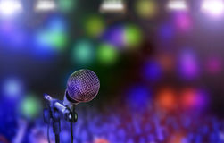 Microphone on stage against Royalty Free Stock Images