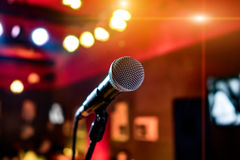 Microphone on stage. Against a background of auditorium stock photo