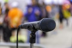 Microphone on stage. Against a blurred background Stock Images