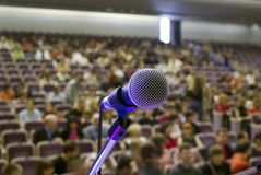 Microphone on the stage and auditorium Stock Image