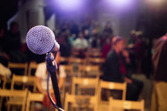Microphone on stage. In the background of the auditorium Royalty Free Stock Images