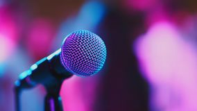 Microphone on stage. Microphone on the background of dancing people stock video footage