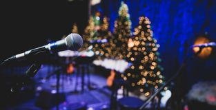 Microphone on stage during Christmas holiday show royalty free stock image