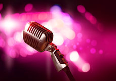 Microphone on stage Stock Images