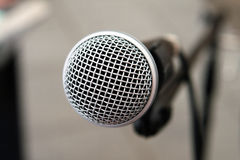 Microphone on stage in closeup Stock Photography
