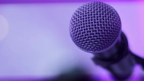 Microphone on stage with colorful lighting stock footage