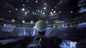 Microphone on stage at a concert venue stock video footage