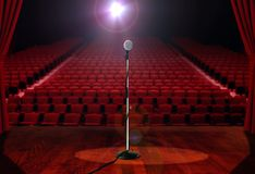 Microphone on Stage with Empty Seats Stock Photos
