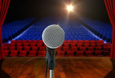 Microphone on stage Facing Empty Seats Royalty Free Stock Image