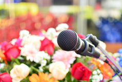 Microphone on the stage and flower background Stock Photos