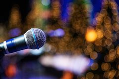 Microphone on stage with golden lights in background royalty free stock images
