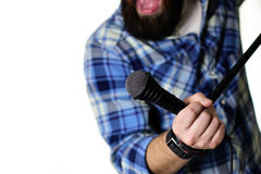 Microphone on stage hand hold Royalty Free Stock Photography