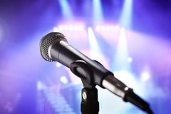 Microphone on stage. Microphone with stage lighting background royalty free stock image