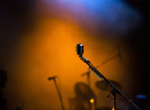 Microphone in stage lights. During concert stock photography
