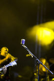 Microphone in stage lights Royalty Free Stock Image