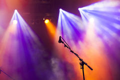 Microphone in stage lights. During concert royalty free stock images