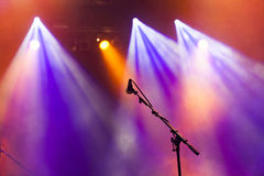 Microphone in stage lights Royalty Free Stock Photo