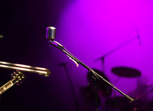 Microphone in stage lights Royalty Free Stock Photography
