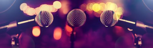 Microphone and stage lights.Concert and music concept stock photography