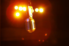Microphone in the stage lights Stock Images