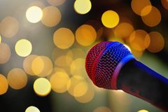 Microphone on stage with bokeh lights royalty free stock image