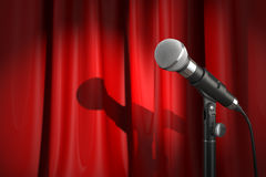 Microphone on stage with red curtain. Music or performance  conc Royalty Free Stock Photos