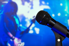Microphone on stage during the rock star show. Concept illustration of a rock concert and musical show Royalty Free Stock Photo