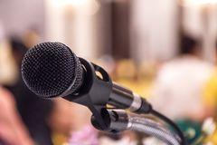 Microphone on stage in conference room with abstract blurred bac royalty free stock photos