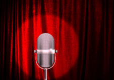 Microphone. A microphone on a stage with a spotlight on it stock photos