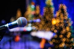 Microphone on stage with twinkle lights in background royalty free stock photo