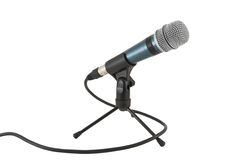 Microphone on the stand. Mike with cord on a table stand isolated on white Stock Photography