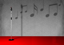 Microphone With Stand. Antique microphone on a stand with music note background and red floor. Also, available with white background Royalty Free Stock Image