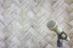 Microphone on a stand with blurred pattern and design of Thai st Stock Photo