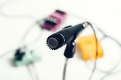 Microphone on stand. With color effects in the back Royalty Free Stock Photography
