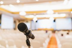 Microphone stand in conference hall blurred background with copy space. Public announcement event, Organization company meeting Stock Photos
