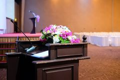 Microphone on stand podium decoration with flower. Select focus with shallow depth of field stock image