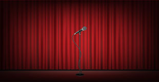 Microphone stand on stage with red curtain background Stock Photo