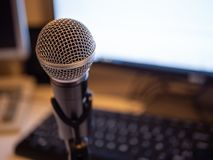 Podcast studio: computer and microphone royalty free stock photography