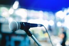 Microphone on a stand up comedy stage stock photo