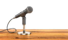 Microphone on the stand on a wood background. Stock Image