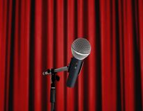 Microphone standing over red curtain. Wireless microphone standing over red curtain Royalty Free Stock Photography
