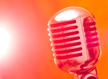Microphone in strobelight Royalty Free Stock Photography
