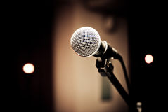 Microphone in studio. On a blur background Stock Images