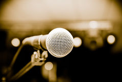Microphone in studio. On a blur background Stock Photos