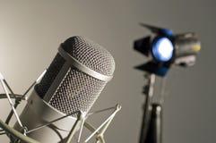 Microphone in studio. Microphone in studio on a light background Royalty Free Stock Photos