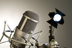 Microphone in studio. Microphone in studio on a light background Stock Photo