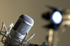 Microphone in studio. Dark blue light Royalty Free Stock Photos