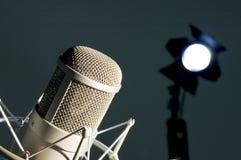 Microphone in studio. Microphone in studio on a dark background Stock Image