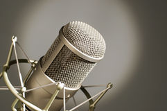 Microphone in studio. Microphone in studio on a light background Royalty Free Stock Images