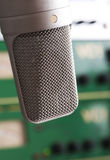 Microphone studio. Big vintage microphone with studio gear in background Royalty Free Stock Photos